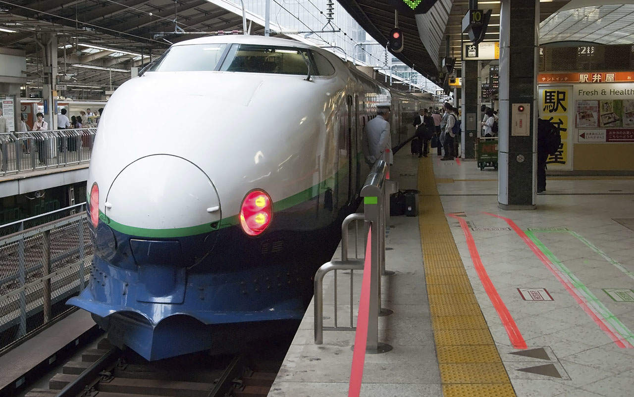 Tokyo, Japan - May 20, 2012: Shinkansen bullet train at Tokyo railway station. Shinkansen is world's busiest high-speed railway operated by four Japan Railways companies.